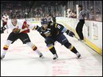 Toledo's Dajon Mingo keeps Indy's Dylan Clarke (24) at bay in a game earlier this year. Mingo will be a numbers casualty on the Walleye's playoff roster heading into the opening round series vs Reading.