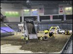 A hundred truckloads of dirt were dumped and spread on the floor of the Huntington Center Thursday in preparation for Monster Jam, with shows at 7 p.m.; 2 and 7 p.m. Saturday, and 2 p.m. Sunday.