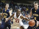 Lima Senior's Jaylin Thomas chases a loose ball against Whitmer's Sam Hickey, right, during a Division I boys district basketball semifinal at Savage Arena. Lima Senior is now 25-0, while Whitmer dropped to 18-7.