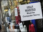 A 'Help Wanted' sign hangs in a store window in New York. U.S. employers added a robust 242,000 workers in February as retailers, restaurants, and healthcare providers drove another solid month for the resilient American job market.