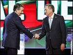 Republican presidential candidate Ted Cruz, left, shakes hands with Ohio Gov. John Kasich at the start of a Republican presidential debate in March.