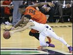 Akron's Noah Robotham, front, and Bowling Green's Rasheed Worrell go after the ball in a Mid-American Conference tournament semifinal Friday in Cleveland. The Falcons finish the season with a 16-18 record.