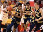 After sweating it out on the bubble, Derrick Walton Jr. (10) and his Michigan teammates will play in the NCAA Tournament.