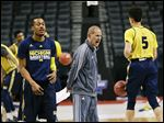 Michigan coach John Beilein calls out to his team during practice Thursday for today's game against Notre Dame in the NCAA Tournament in Brooklyn.