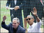 President Obama, right, and Cuban President Raul Castro wave to fans as they arrive for a baseball game between the Tampa Bay Rays and the Cuban national baseball team in Havana.