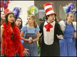 From left, Sunita Dhar, 15, playing Mayzie La Bird; Allie Gehling, 16, playing Jo-Jo; Max Ruff, 18, playing the Cat in the Hat, and Taylor Surgeon-Hess, 17, playing Gertrude, sing together during a preview performance of Southview's 'Seussical.' The cast of about 150 students on March 21 was preparing for the April 14-17 performances.