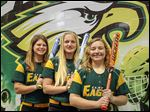 Clay softball players Haley Dominique, left, Bekah Yenrick, center, and Natalie Quinlan, right, are returning to lead the Eagles on the softball field. The Eagles seek to win their fourth straight championship.