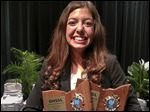 Maddy Vesoulis has won consecutive speech and debate state championships.