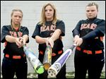 From left, Gibsonburg softball players Shylee Schmeltz, Allie Teeple, and Abby Cantrell could keep the Golden Bears atop the Toledo Area Athletic Conference standings.