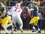 Michigan quarterback Wilton Speight throws against Ohio State during the fourth quarter Nov. 28 in Ann Arbor. Speight is in the running for Michigan's starting quarterback.