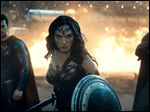 Henry Cavill as Superman, left, Gal Gadot as Wonder Woman and Ben Affleck as Batman in a scene from