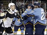 The Toledo Walleye's Tylor Spink and Wheeling's Clark Seymour scuffle during today's game at the Huntington Center.