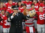 In this Sept. 7, 2013, file photo, Ohio State University marching band director Jonathan Waters leads the band in