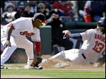 Boston's Hanley Ramirez slides safely into third base as Cleveland's Juan Uribe is late on the tag in the sixth inning of the Red Sox victory.