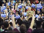 The crowd cheers as Democratic presidential candidate Hillary Clinton calls for an end to gender-based wage discrimination during a rally in Skibo Gymnasium at Carnegie Mellon University.