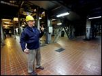 Neil Dziedzic, plant manager at the J.R. Whiting power plant in Monroe County, gives a tour of the coal-fired facility. The power station is one of many being shuttered as markets shift toward natural gas and clean, renewable energy.
