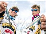 Adrian College Bass Fishing Team members Jarrett Martin, left, of Gallipolis, Ohio, and Jacob Bayer of Blissfield show the Rapala Shadow Rap lures they used to place seventh in FLW National Collegiate Championships on South Carolina's Lake Keowee.