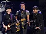 Bruce Springsteen, center, performs with Nils Lofgren, left, and Steven Van Zandt of the E Street Band during their March 15 concert in Los Angeles.