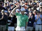 Danny Willett, of England, celebrates on the 18th hole after finishing the final round of the Masters.