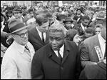 In this March 5, 1964 file photo, former baseball star Jackie Robinson, center, appears with demonstrators in a civil rights march on the capitol in Frankfort, Ky. Robinson is the subject of a two-part documentary, 'Jackie Robinson' directed by Ken Burns, Sarah Burns and David McMahon.