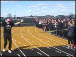 Community members, parents, and Perrysburg High School track athletes cheered on 87-year-old Walt Churchill as he crossed the finish line, which on Tuesday also served as a ribbon cutting for the new track at Perrysburg High School.
