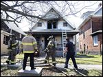 Toledo firefighters finish battling a blaze at 135 West Park St.  Three people were injured in the fire Thursday. The cause has not yet been determined, authorities said.