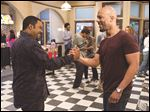 Ice Cube, left, and Common appear in a scene from