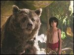 Neel Sethi stars as Mowgli and Bill Murray voices the bear Baloo the bear in the latest adaptation of
