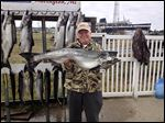 Jim Stanley of Indiana proudly hoists his first Lake Michigan king salmon, caught in 2014 aboard Wild Thing Charters, which is based in Ludington, Mich.