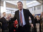 Republican presidential candidate John Kasich dances after being introduced at a town hall at Savage Mill in Savage, Md., on Wednesday. On Friday he told a young female college student, who said she was worried about sexual harassment and violence, that she should avoid parties with a lot of alcohol.