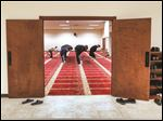 Sayed Saleh Qazwini, right, leads others in Friday prayers at Ahlul Bayt Center of Toledo.