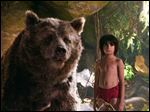 Mowgli, portrayed by Neel Sethi, right, and Baloo the bear, voiced by Bill Murray, appear in a scene from,