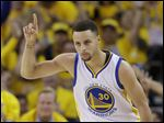 Golden State's Stephen Curry celebrates after scoring against the Houston Rockets during the first half in Game 1 on Saturday.