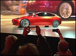 Tesla Motors unveils the new lower-priced Model 3 sedan at the Tesla Motors design studio in Hawthorne, Calif. It doesn't go on sale until late 2017, but so far,  325,000 people worldwide have put down deposits of $1,000. Researchers say that doesn't mean mainstream America is ready for electric vehicles.