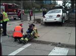 A Toledo firefighter comforts a child at the scene of a crash at Superior and Jackson streets.