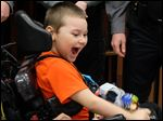 Alexander Craig, 6, is surrounded by Explorers from left Tyler Ware, Lucas Harmon and Chris Teare during his Make-A-Wish party at the UAW Local 12 Hall in Toledo. With him is his registered nurse, Jacquel McCadney, who is also going to Disney.