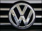 A person briefed on the matter says Volkswagen has reached an agreement with the U.S. government to spend just over $1 billion to compensate owners of diesel-powered cars that cheat on emissions tests.