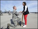 Staff Sgt. Adam Hill proposes to  girlfriend Lindsay Miller of Columbus after he and more than 200 airmen from the 112th Expeditionary Fighter Squadron return to the 180th Fighter Wing Air National Guard Base at Toledo Express Airport.