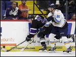 Reading forward Ian Watters, left, skates past Toledo's Evan Rankin at Santander Arena in Tuesday night's playoff game.