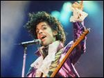 In this 1985 file photo, Prince performs at the Forum in Inglewood, Calif. Prince, widely acclaimed as one of the most inventive and influential musicians of his era. was found dead at his home today.