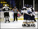 Toledo's Matt Caito (12) and teammates celebrate a first-period goal by A.J. Jenks against Reading in Wednesday night's Game 4 of the ECHL Eastern Conference quarterfinals at Santander Arena.