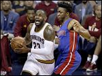 The Cavaliers' LeBron James drives past the Pistons' Stanley Johnson in the first half in Game 2 of their NBA first-round playoff series Wednesday night in Cleveland. James finished with 27 points.