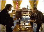 Michael Shannon portrays Elvis Presley, left, and Kevin Spacey portrays President Richard Nixon in a scene from