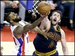 Detroit's Marcus Morris, left, makes a layup while Cleveland's Kevin Love tries to block in Game 3 at The Palace in Auburn Hills, Mich.