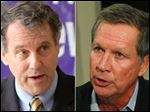 U.S. Sen. Sherrod Brown, left, and Ohio Gov. John Kasich, right.