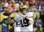 Michigan quarterback Jake Rudock throws a pass against Florida during the first half of the Citrus Bowl in January. Rudock was taken in the sixth round of this year's draft, the same round as Tom Brady.