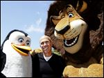 DreamWorks Animation CEO Jeffrey Katzenberg plays with 'Madagascar' characters Alex the Lion and Kowalski the Penguin during a groundbreaking opening of DreamWorks studios in Redwood City, Calif.