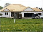 A home being built under a contract in the Ironwood subdivision in Rossford moves closer to completion.