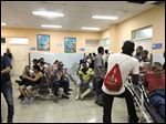 Cubans sit in an outpatient waiting room at Calixto Garcia University Hospital. The waiting rooms at the facility were clean, and the people in them were relatively patient.