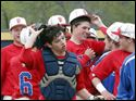Carter Smith of St. Francis, center smiling, and the Knights celebrate their victory.